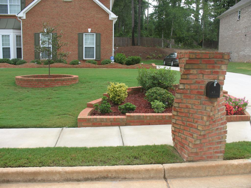 Brick flowerbed, tree, island and mailbox. from jackpot construction ...