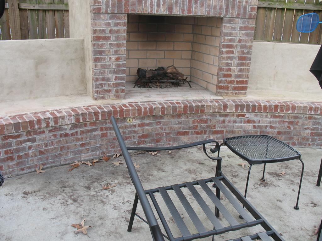 custom stucco brick outdoor fireplace from jackpot construction in