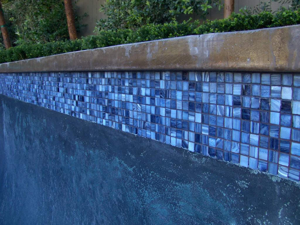 clean glass pool tile after by pool tile cleaning orange