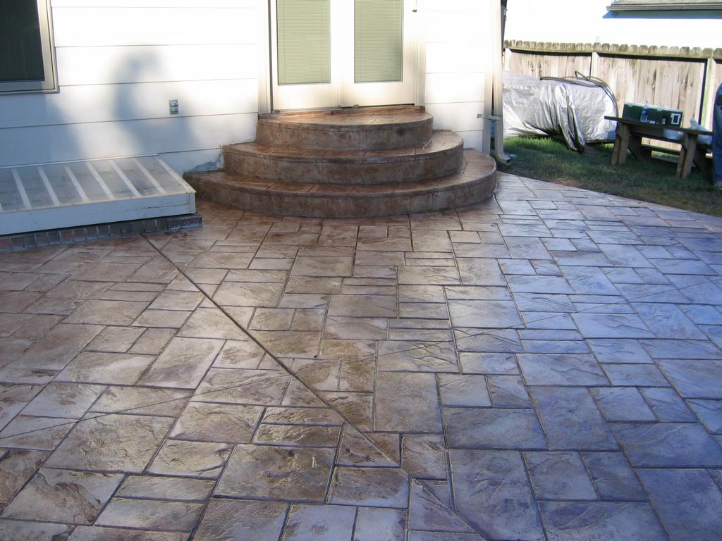 Patio and steps done in ashlar slate pattern from concrete - Concrete porch steps ideas ...