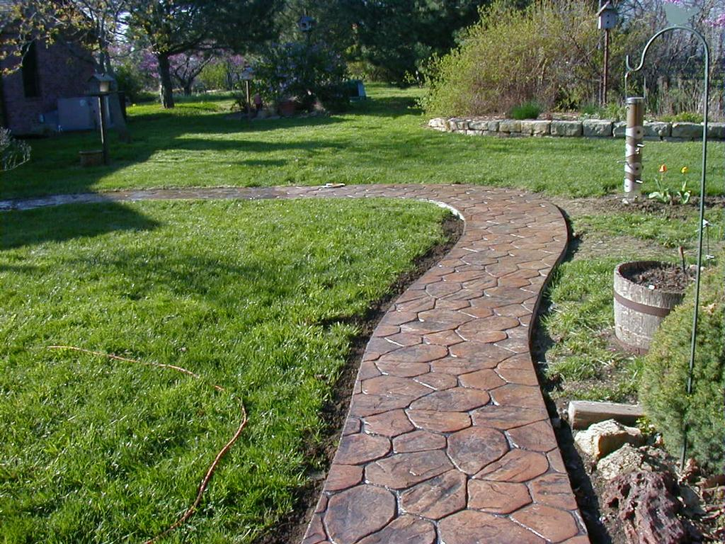 Sidewalk In Random Rock From Concrete Designs Inc In