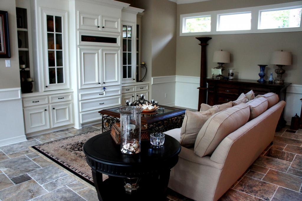 living room remodeling travertine tile floors.jpg from Houston Flooring Center in Houston, TX 77084