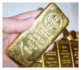 hand-holding-gold-bar-774372 by Crossroad Pawn Shop