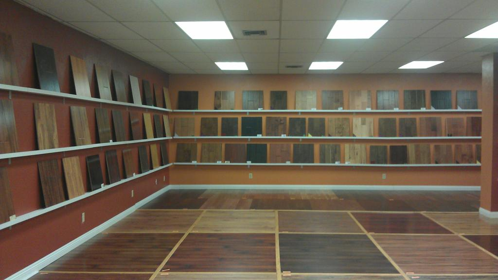 Laminate hardwood tile vinyl flooring store showroom from for Laminate flooring stores
