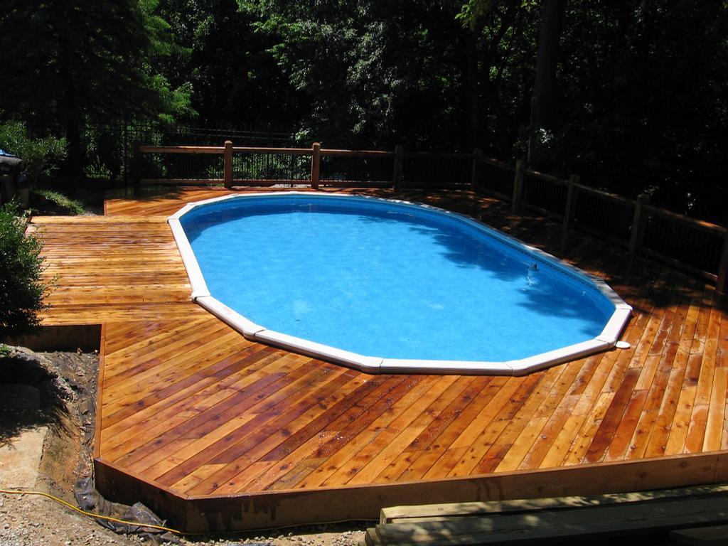 Cedar deck around above ground pool by dream decks for Decking around a pool