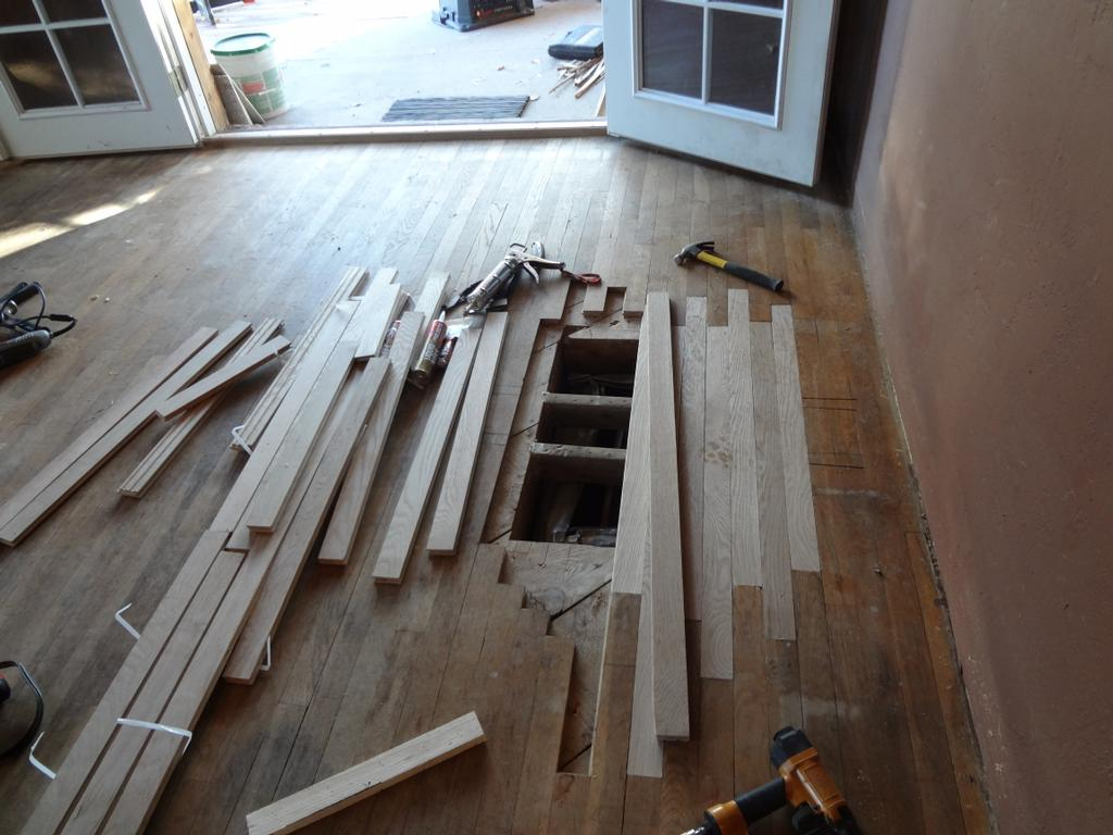 Damaged wood flooring planks removal and reinstallation for Hardwood flooring installation peoria il
