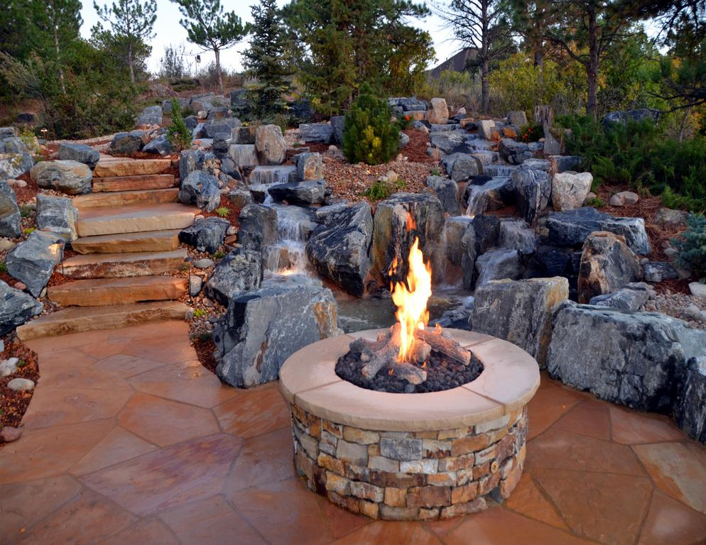 stone fire pit with naturalistc water feature in from mile high landscaping in denver. Black Bedroom Furniture Sets. Home Design Ideas