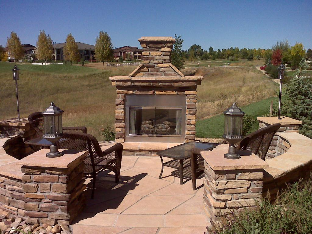 Outdoor Gas Fireplace With Masonry Seat Walls And Flagstone Patio