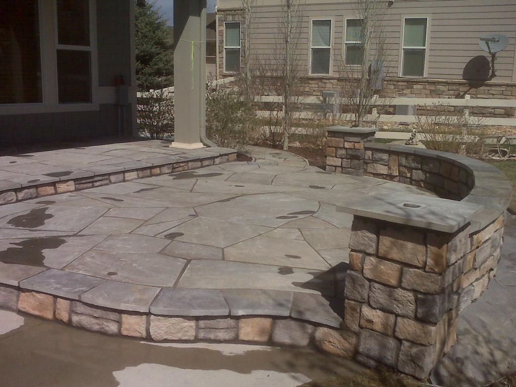 Blue Flagstone Patio With Seat Walls And Pillars From