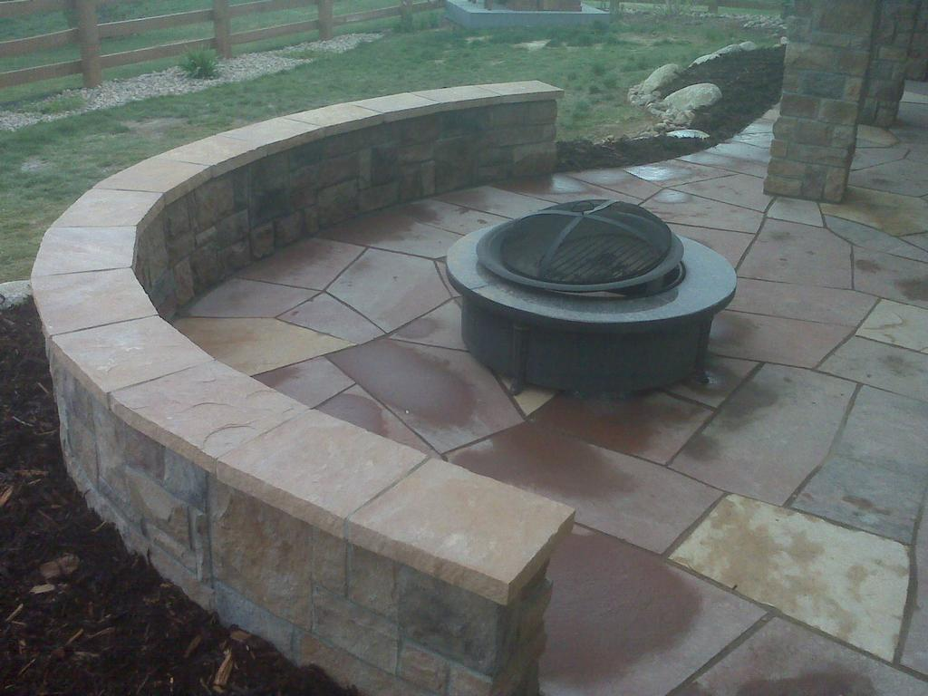 Flagstone Patio With Seat Walls From Wildflower Landscape