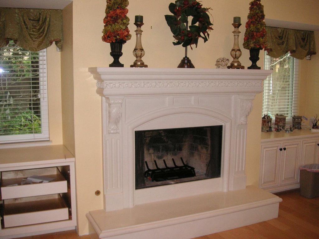 38 a fireplace mantel with acanthus details corbels