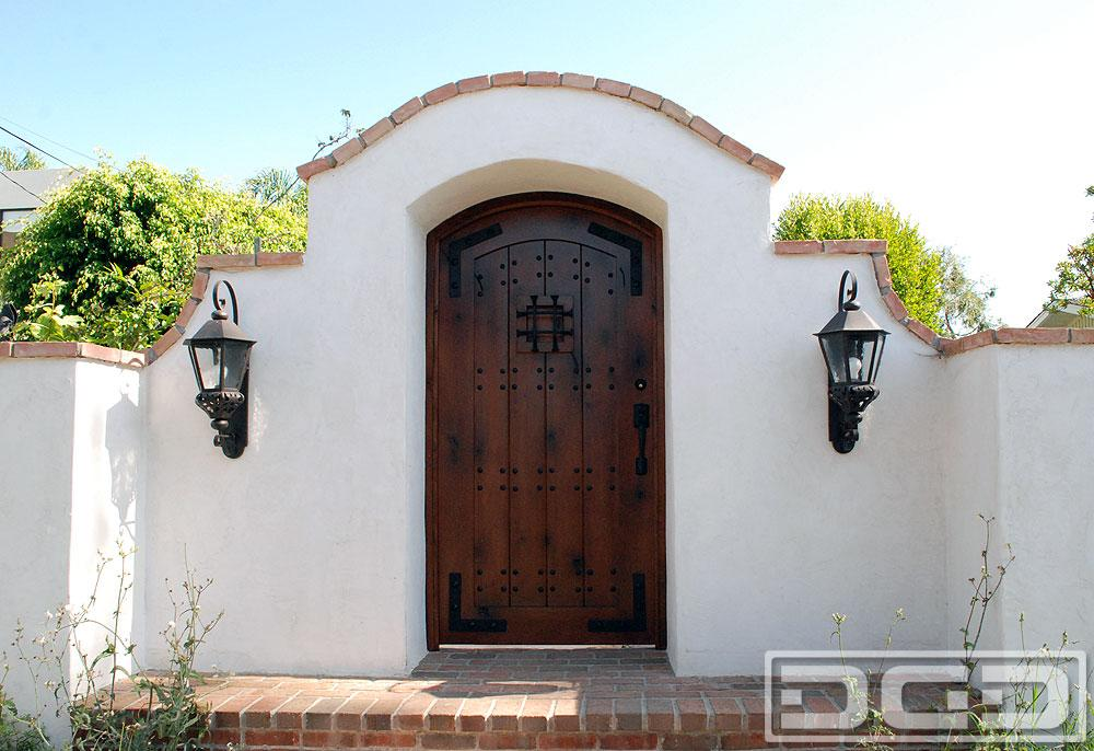 Spanish european entry gate with decorative iron clavos for European garage doors
