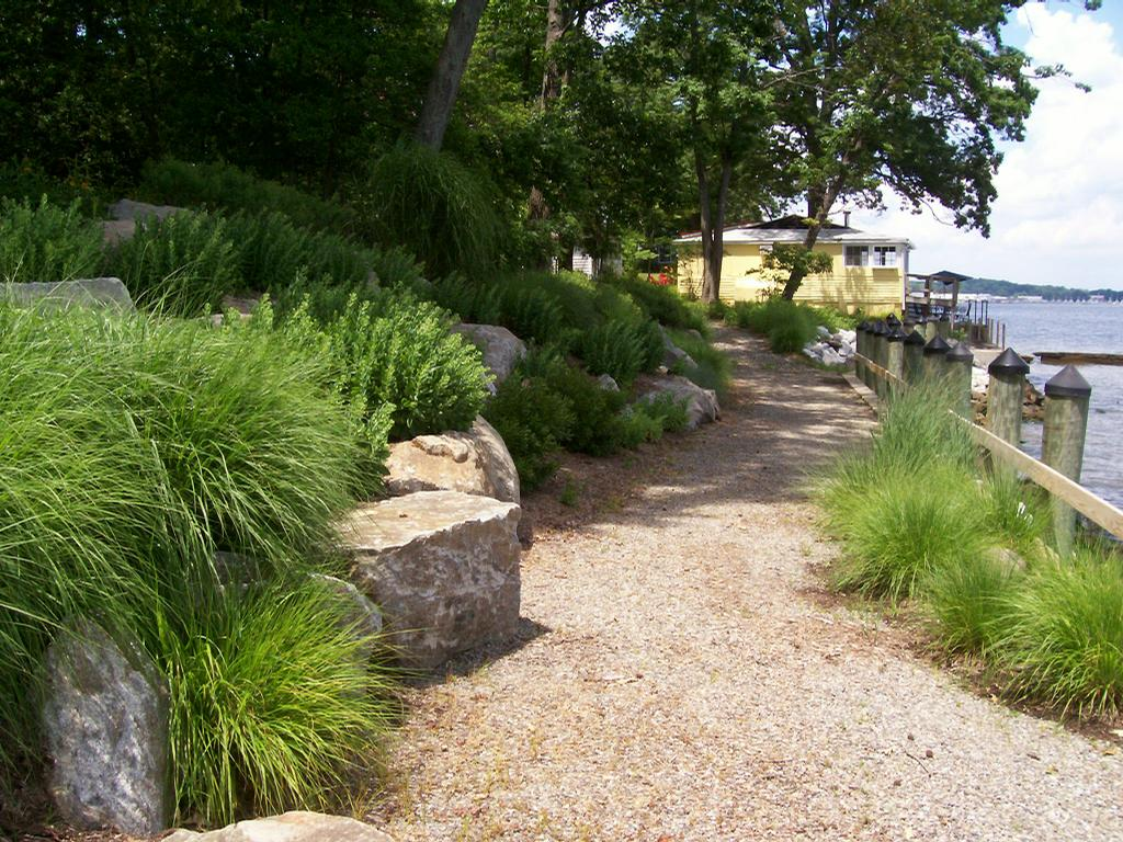 Waterfront boulder retaining walls maryland company from for Land design landscaping