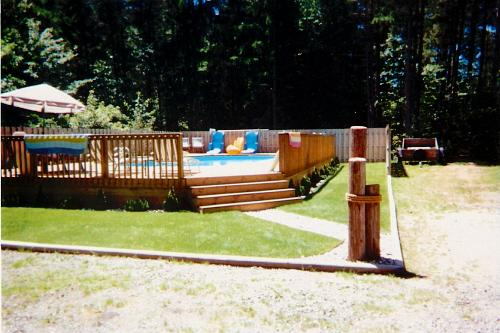Inground above ground swimming pool patio sales - Custom above ground pool ...
