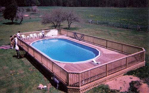 Pictures for holiday pool patio custom swimming pool for Swimming pool installation companies