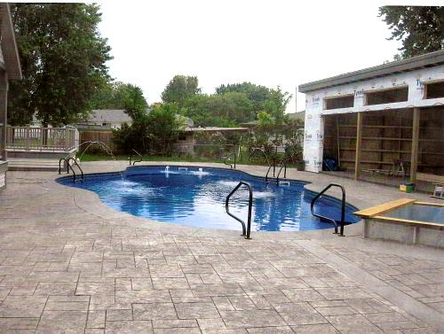 Pictures for holiday pool patio custom swimming pool for Pool installation companies