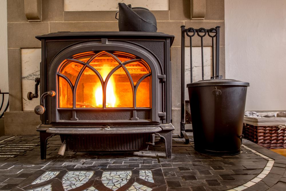 High efficiency cast iron wood stove burning firewood - How To Identify Fisher Wood Stoves - <NavigationCategory Home-and